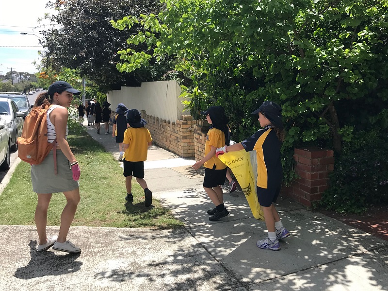 Students from St Joseph's Primary School, Elsternwick, on a street clean-up as part of their Living Waters Workbee