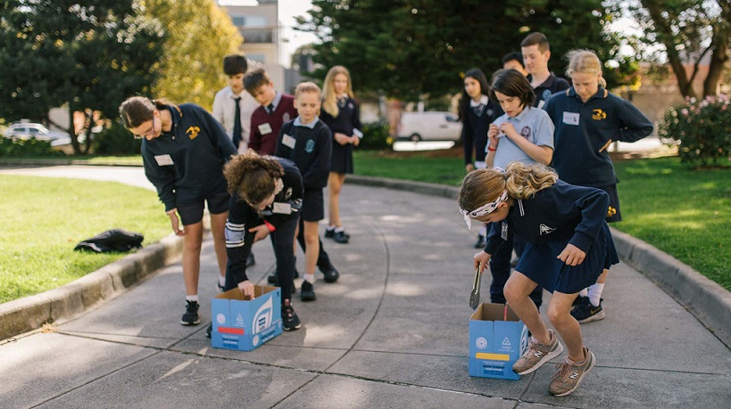 Children competing in a litter relay